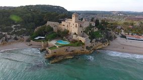 Sunset on the beach of Castle of the Marquises, Tamarit , Tarragona, Spain. A medieval castle with romanesque style on a small promontory overlooking the sea and stock footage
