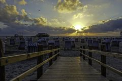Sunset at the beach with beach chairs North Sea Germany stock image