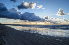 Sunset on the beach with cloudy sky, Baltic sea, Jurmala, Latvia.  stock images