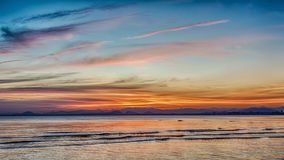 Sunset at beach colorful cloudy Stock Photo