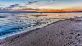 Sunset at beach colorful cloudy Stock Photos