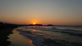 Sunset on the beach. Crete Greece Rethymno sunset on the beach listening to the sea stock footage