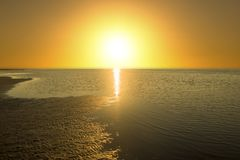 A sunset on the beach of delta del ebro stock images