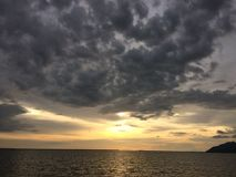 Sunset by the beach with dramatic cloud Royalty Free Stock Photo