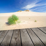 Sunset on the beach and empty wooden deck table. Royalty Free Stock Photos