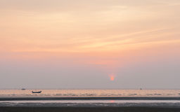 Sunset on the beach with fisherman's boats. Stock Photo