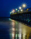 Sunset Beach fishing Pier at night Royalty Free Stock Images