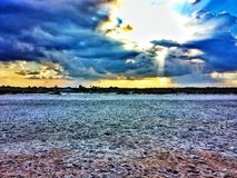 Sunset at the beach. A gold and blue sunset over sand at the beach in St Augustine, Florida Stock Photo