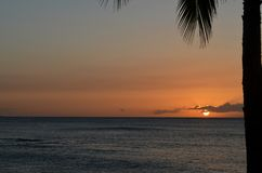 Sunset on the beach in Hawaii royalty free stock photography