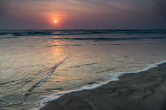 Sunset on the beach. Of the Indian ocean Royalty Free Stock Image