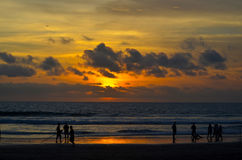 Sunset beach. On an island in Indonesia, and silhouettes of people Royalty Free Stock Images