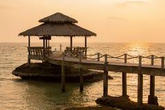 Sunset on the beach. Island Koh Kood, Thailand. Tropical sand beach with pier near sea water on the sunset Royalty Free Stock Photo
