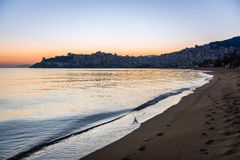 Sunset on the beach in Kavala, Greece royalty free stock photo