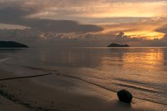 Sunset at Beach Koh Phangan with Coconut royalty free stock images