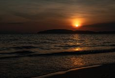 A sunset on a beach in Krabi. stock photo