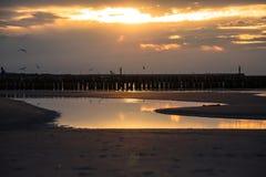Sunset on the beach in Leba, Baltic Sea, Poland Royalty Free Stock Photos