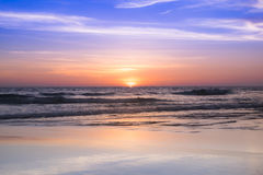 Sunset at the beach. With light golden time and the sky reflection with surface ,background,noised and gain Royalty Free Stock Images