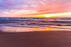 Sunset by the beach. A long day coming to a close with a beautiful sunset Royalty Free Stock Photos