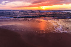 Sunset by the beach. A long day coming to a close with a beautiful sunset Stock Photography