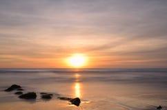 Sunset at the beach, long exposure shot Stock Photo