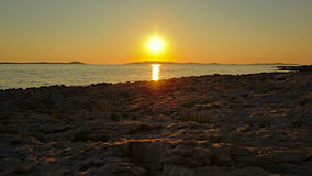 Sunset on the beach of Mali Losinj island, Croatia. Sunset over the Adriatic, with islands on the horizon, view from the beach of Mali Losinj, Croatia Royalty Free Stock Photo