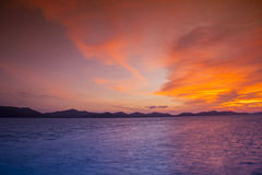 Sunset at the beach and the mountains a Beautiful Royalty Free Stock Photography