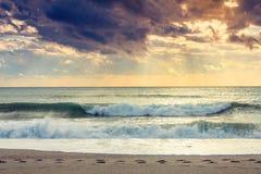 Sunset beach Stock Images