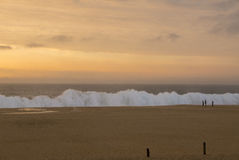 Sunset on beach near Espichel Cape with massive ocean waves in P Stock Image