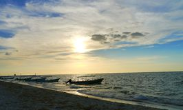 Sunset beach ocean panorama fisherboat Stock Image