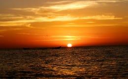 Sunset beach ocean panorama fisherboat Royalty Free Stock Photo