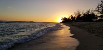 Sunset at the beach in Ohau Hawaii royalty free stock image