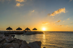 Sunset at the beach - palapa Stock Photos
