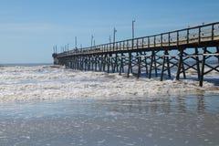 Wooden Pier at Sunset Beach, North Carolina. Sunset Beach Pier in the Atlantic Ocean on Sunset Beach, North Carolina Royalty Free Stock Image