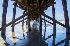 Wooden Pier at Sunset Beach, North Carolina. Sunset Beach Pier in the Atlantic Ocean on Sunset Beach, North Carolina Stock Photography