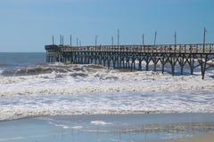 Wooden Pier at Sunset Beach, North Carolina. Sunset Beach Pier in the Atlantic Ocean on Sunset Beach, North Carolina Stock Photo