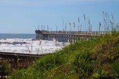 Wooden Pier at Sunset Beach, North Carolina. Sunset Beach Pier in the Atlantic Ocean on Sunset Beach, North Carolina Royalty Free Stock Images