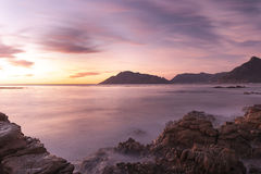Sunset on the beach. Sunset in pink and pastel colours on the beach Stock Photo