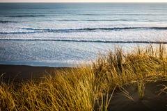 Sunset on a beach Stock Image