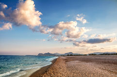 Sunset on the Beach, Rhodes island, Greece Royalty Free Stock Image