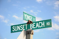 Sunset Beach Road Sign Stock Photo