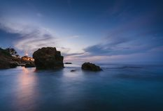 Sunset on the beach among the rocks near the city of Denia. District of Valencia, Spain. stock photography