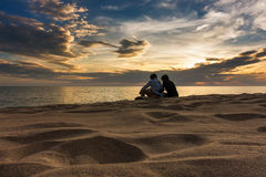 Sunset on the beach, Romantic scene Stock Images