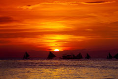 Sunset on beach with sailng boats. Sunset on tropical beach with sailng boats Stock Image