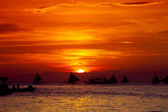Sunset on beach with sailng boats. Sunset on tropical beach with sailing boats Royalty Free Stock Photography