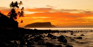 Sunset at a beach in Samoa Stock Photography