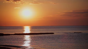 Sunset at the beach. sea sunset. Pier into the sea stock video