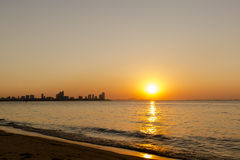 Sunset on the beach. With silhouette building and mountain, Pattaya,Thailand Stock Images