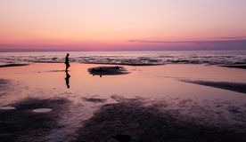 Sunset on the beach and silhouette of man, Jurmala Royalty Free Stock Photos