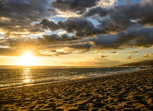 Sunset on the beach with spectacular clouds Royalty Free Stock Photo