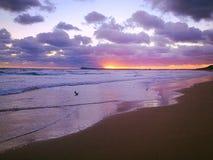 Sunset beach. A spectacular sunset over the beach stock photo